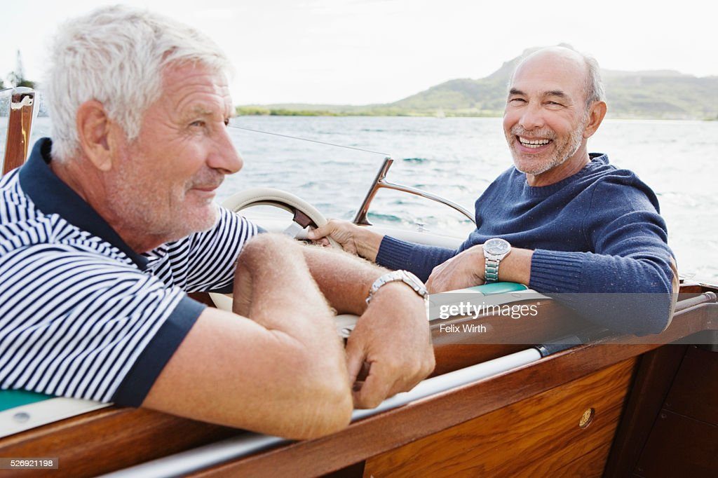 Two senior friends in motorboat : ストックフォト