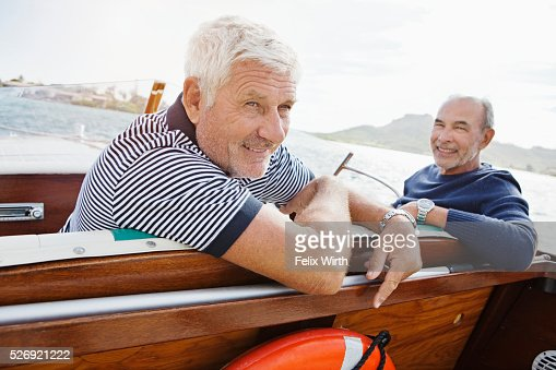 Two senior friends in motorboat : Stock-Foto