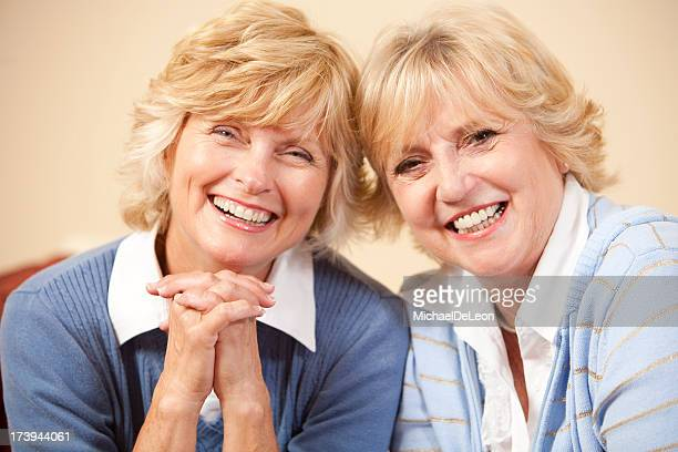 Two senior ladies smiling at the camera