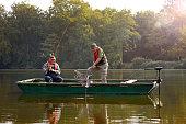 Two senior man catching fish