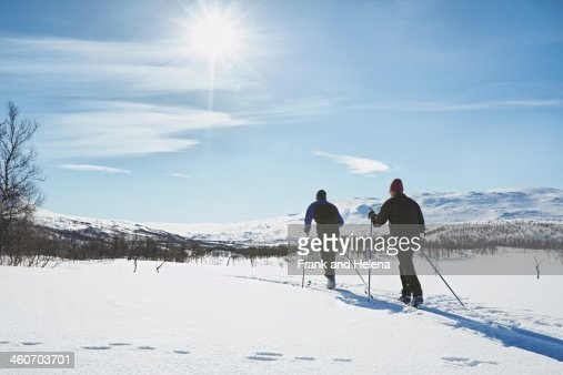 Two senior men cross country skiing, Hermavan, Sweden