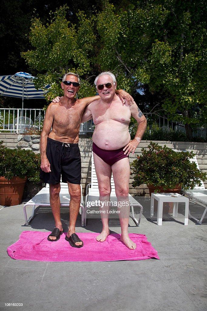 Two senior men in bathing suits laughing