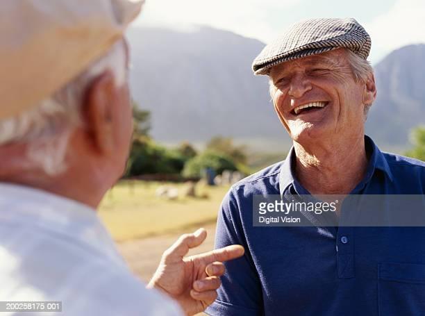 Two senior men outdoors, smiling