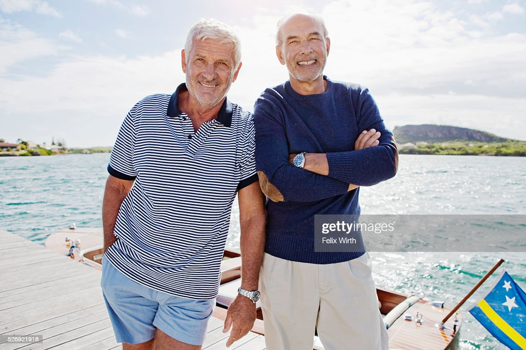 Two senior men standing on jetty : Foto de stock