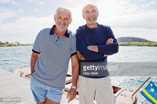 Two senior men standing on jetty : Bildbanksbilder