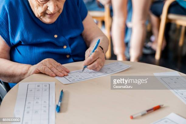 Two Senior Women In The Retirement Home Playing Bingo - Close Up