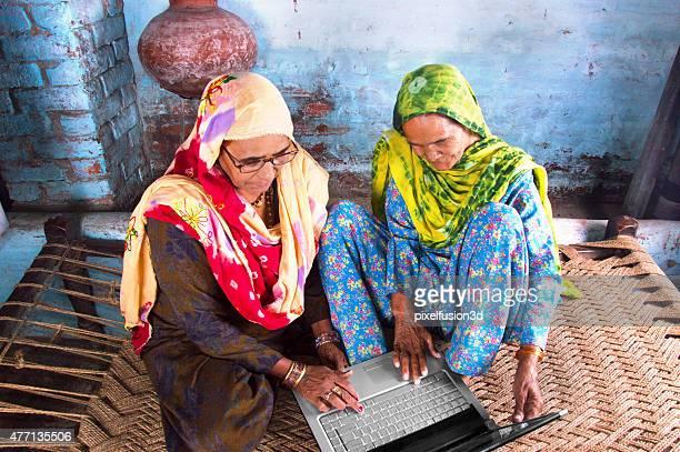 Two Senior Women Using Laptop