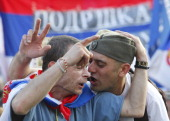 Two Serbian protesters sing nationalist songs during a rally organized by the ultra nationalist Serbian Radical Party in front of the Parliament...
