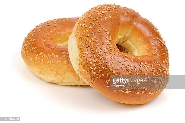 Two Sesame Seed bagels isolated on white background