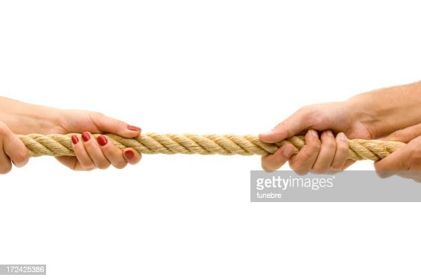 Two sets of hands pulling a rope from opposite sides
