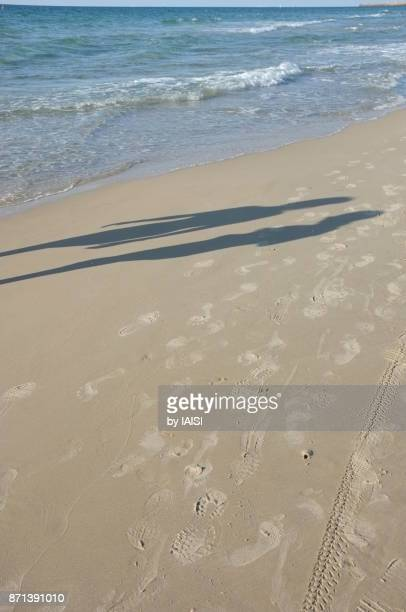 Two shadows at the beach
