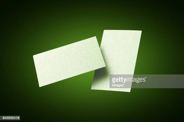 Two Sides of Green Colored Blank Cards Levitation