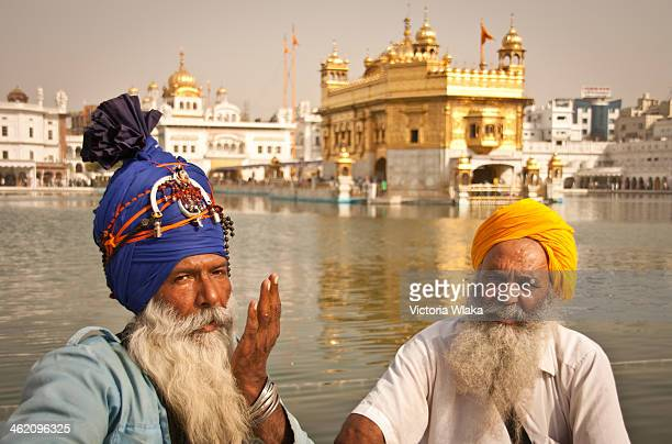 CONTENT] Two Sikh gentlemen wearing beautiful turbans at Harmandir Sahib on a morning in May 2011