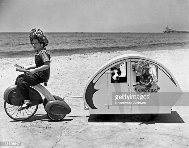 Two sisters do the beach tour along with their dog and cat Venice California July 7 1938