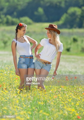 Two sisters in field : Stock Photo