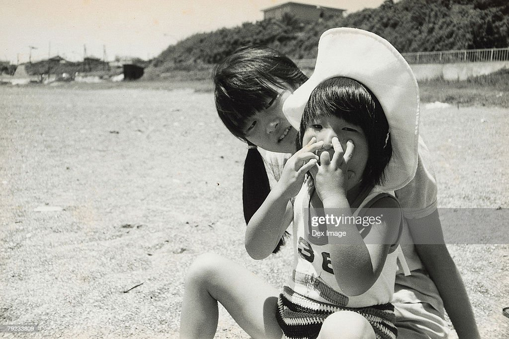 Two sisters on the beach : Stock Photo