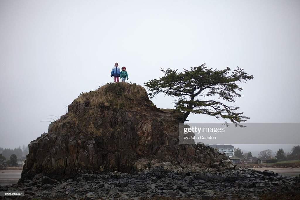 Two sisters on top of a rock in Siletz Bay