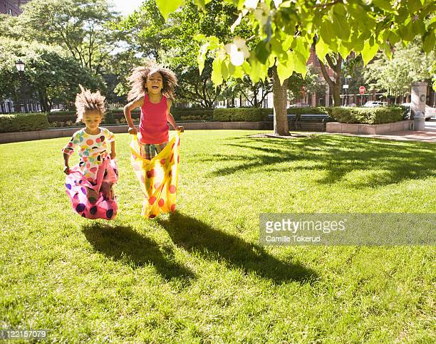 Two sisters playing in the park
