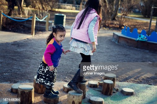 Two sisters playing on playground : Stock Photo