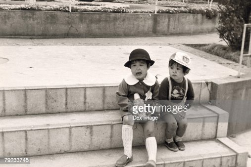 Two sisters sitting on the steps : Stock Photo