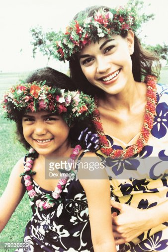 Two sisters wearing traditional hula dancing outfits : Stock Photo
