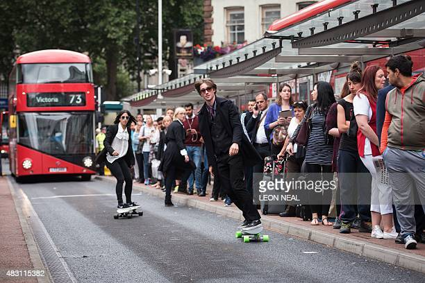 Two skaters take part in a promotional event by Penny Skateboards giving free boards to stranded commuters as a 24 hour tube strike hits the morning...