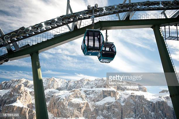 Two ski lifts with rocky mountains in the background at Selva, South Tyrol, Italy,