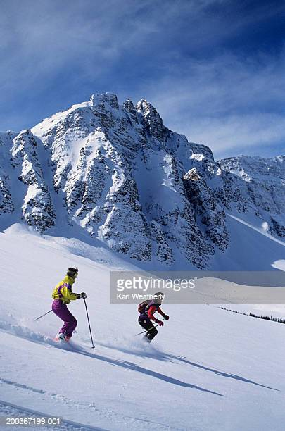 Two skiers at Marmot Basin, Jasper National Park, Alberta, Canada