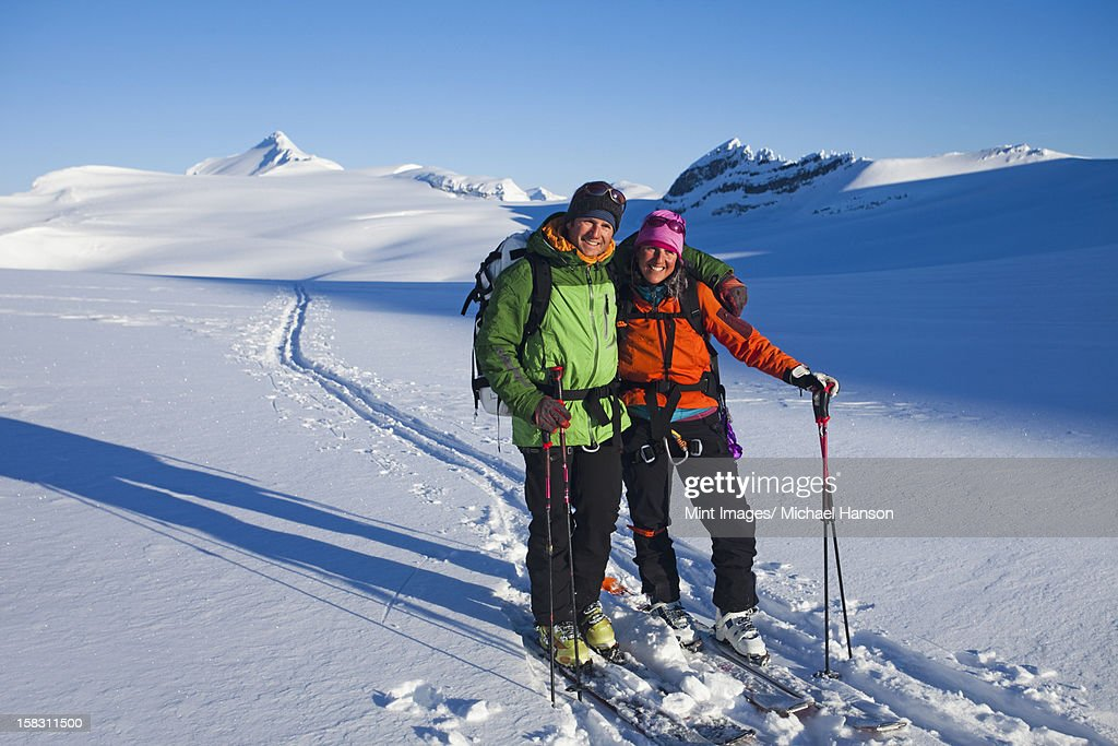 Two skiers on the Wapta Traverse track, a hut-to-hut ski tour in the Rockies in Alberta, Canada. : Stock Photo
