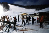 Two skiers walks with their skies to a ski lodge in Stowe VermontPhoto by Ivan Dmitri/Michael Ochs Archives/Getty Images