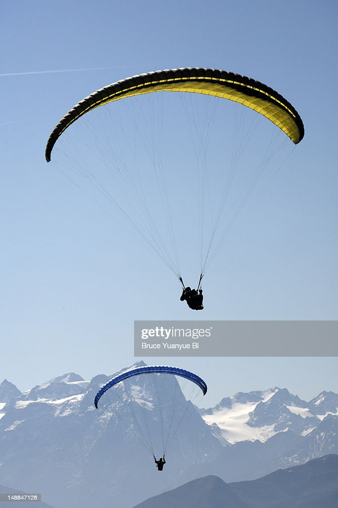 Two skydivers flying over Seefeld valley. : Stock Photo