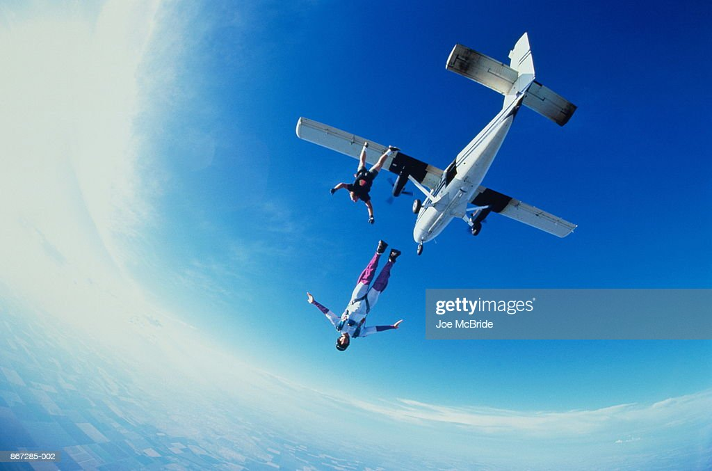 Two skydivers jumping off an airplane : Stock Photo