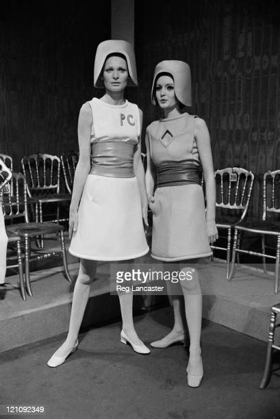 Two sleeveless belted dresses by Pierre Cardin at a fashion show 1967 They are worn with helmetstyle hats