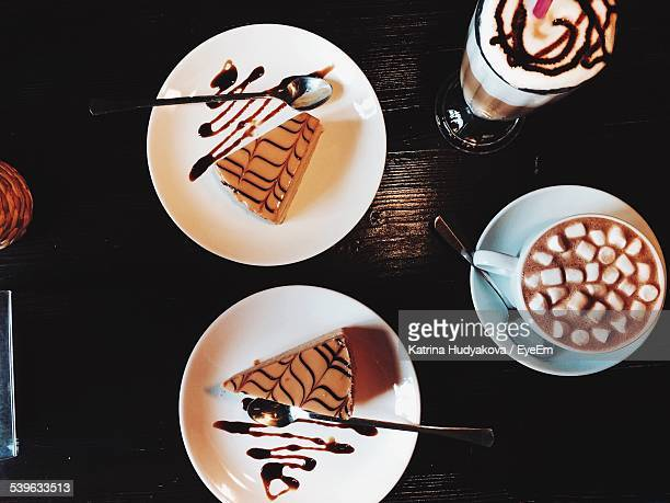 Two Slices Of Cake And Two Coffee Cups On Table