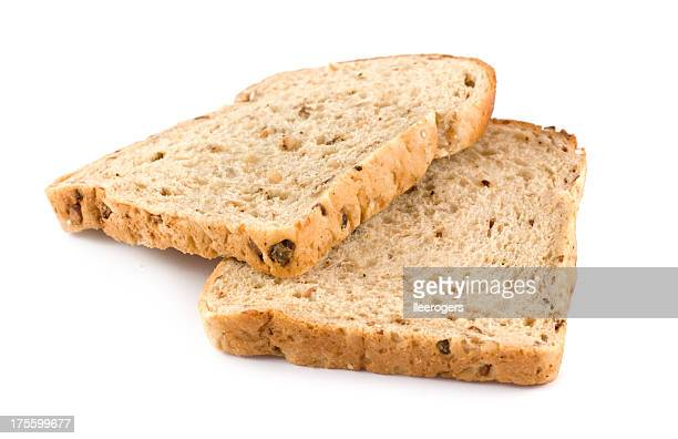Two slices of wholemeal brown bread on a white background