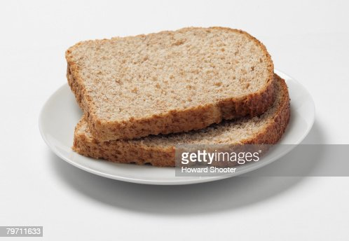 Two Slices Of Wholewheat Bread On A Plate Studio Shot ...