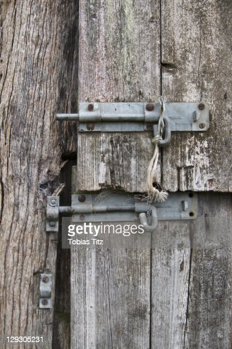 Two Slide Latches On A Warped Wooden Door Stock Photo | Getty Images