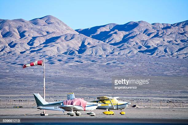 Two small airplanes at airport, Atacama Desert, Chile