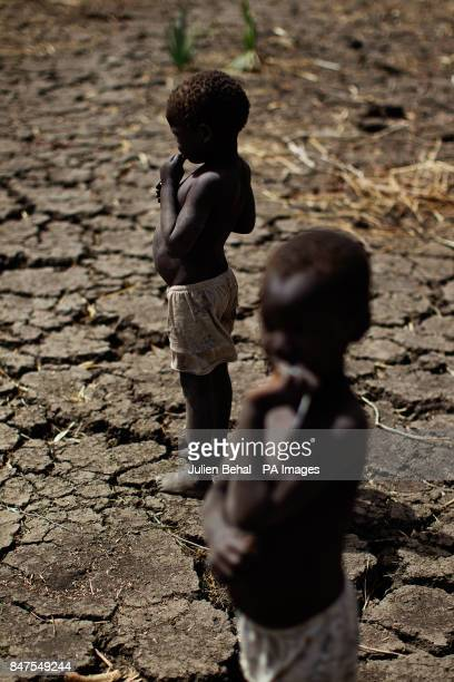 Two small boys stand on parched earth in Doro refugee camp in BunjMaban in the Upper Nile Blue Nile state of northeastern South Sudan AfricaThe...