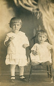 A brother and sister in the Edwardian Style. Early 20th Century photo restored.
