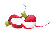 two small red garden radish with half and slices isolated on white background