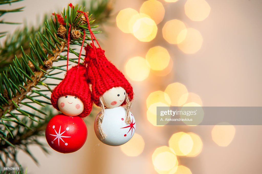 Two small toys on Christmas tree