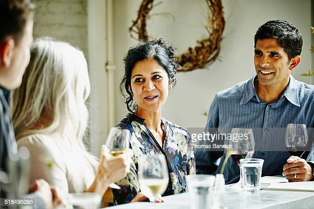 Two smiling couples having drinks in bar