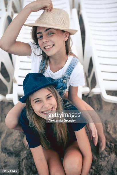 Two Smiling Girls Having Fun at Summer Beach