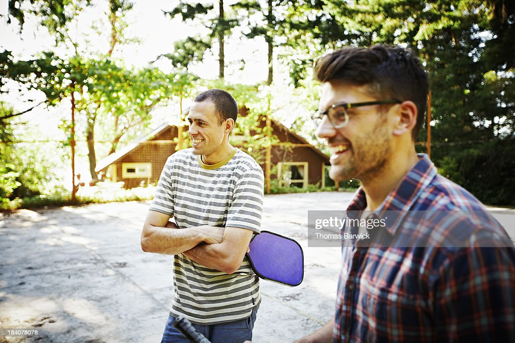 Two smiling male friends on sport court : Stock Photo