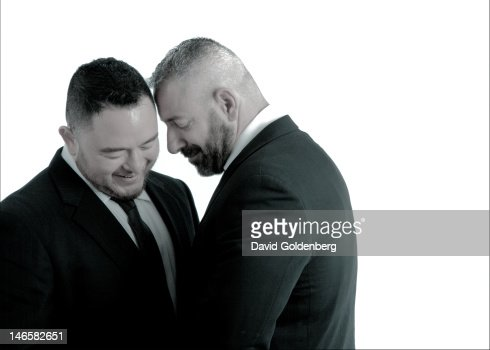 Two smiling man in black suits : Stock Photo