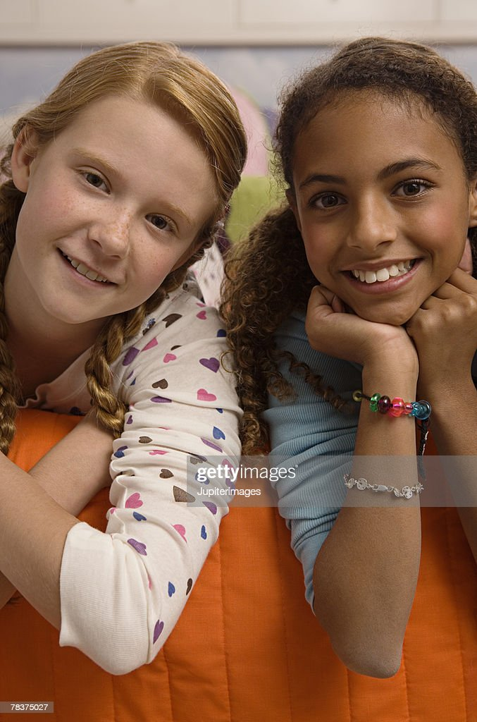 Two Smiling Preteen Girls Stock Photo | Getty Images: http://www.gettyimages.com/detail/photo/two-smiling-preteen-girls-royalty-free-image/78375027