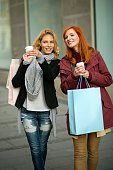 Two smiling woman shopping.