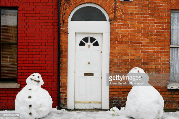 Two snowmen outside a house in Dublin as the country braces itself for continued bad weatherPicture date Sunday January 10 2010 See PA story WEATHER...