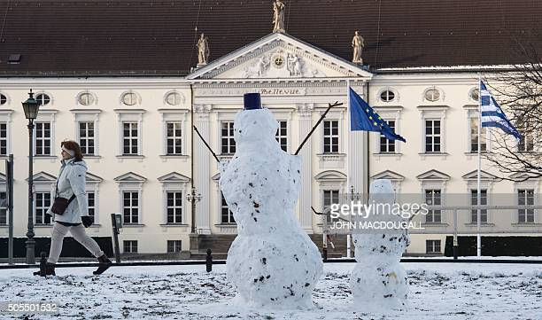 Two snowmen stand in front of the presidential palace in Berlin on January 18 after snowfall in the capital / AFP / John MACDOUGALL
